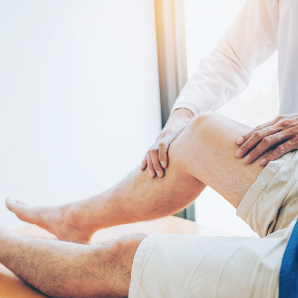 Physical Doctor consulting with patient Knee problems Physical therapy concept
